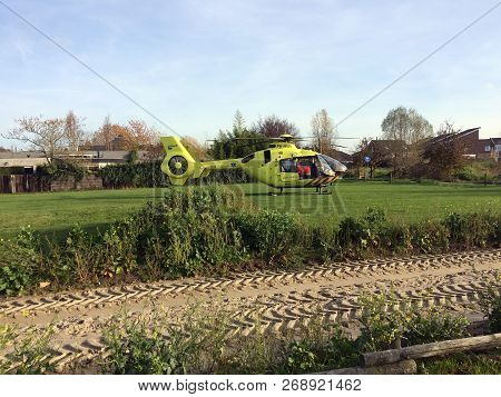 Tiel, The Netherlands - November 14, 2018: Yellow Medical Helicopter Landed To Assist In Medical Aid