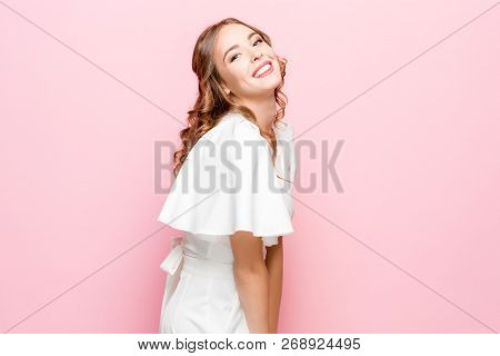 Happy Business Woman Standing And Smiling Isolated On Pink Studio Background. Beautiful Female Half-