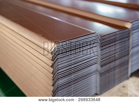 Sheets Of The Profile Sheet Are Stacked In A Warehouse Rack