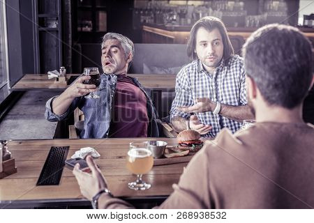 Frustrated Male Person Staring At Bocal With Beer
