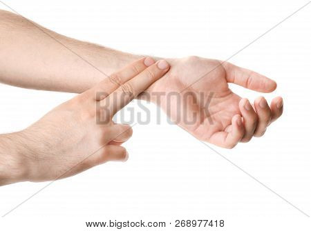 Man Checking Pulse On Wrist Against White Background, Closeup