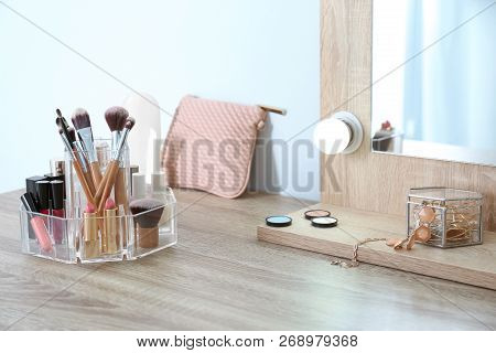 Organizer With Cosmetic Products For Makeup On Table Near Mirror