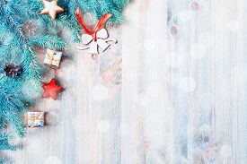 New Year and Christmas background. Christmas toys, blue fir tree branches on the wooden background. New Year and Christmas composition, free space for Christmas text, New year and Christmas still life