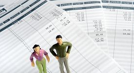 Man And Woman Standing On Pay Sheets For Men And Women Equal Pay Illustration