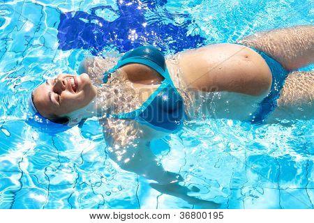 Happy Pregnant Woman Swwing In Swimmingpool