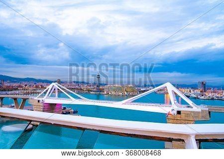 Barcelona, Spain - November 08 2018: Porta D'europa Bascule Mobile Bridge With Torre Jaume I Aerial