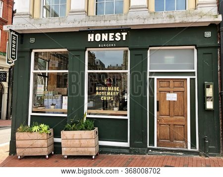 READING, UK - MAY 24, 2020: Outside a branch of Honest Burgers, a chain of gourmet burger restaurants, in Reading, Berkshire, UK.