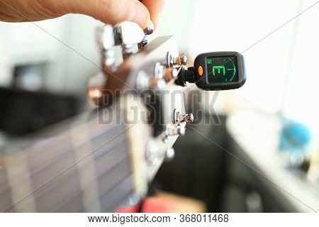 Tuner Is Installed On Guitar Neck For Tuning Notes. Tuner For An Acoustic Guitar. Each String Makes