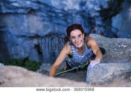 A Woman Is Climbing In Turkey, Turkish Woman Climbs The Rock, Extreme Hobby, Overcoming A Difficult