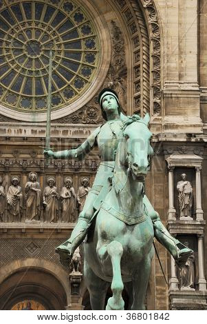 Equestrian statue of Joan of Arc (Jeanne d'Arc) by Paul Dubois in front of the Church of St. Augustine (Eglise Saint-Augustin de Paris) in Paris France. poster