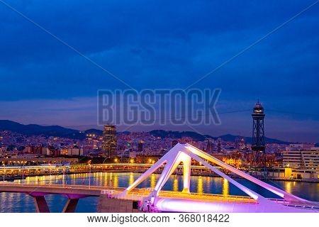 Barcelona, Spain - November 08 2018: Porta D'europa Bascule Mobile Bridge Lit With Night Lights. Tor