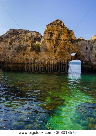 Fantastic Rock Formations Set In A Turquoise Water At Ponta Da Piedade, Lagos, Western Algarve Coast
