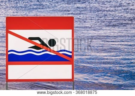 Sign On The Riverbank Swimming Is Prohibited, A Prohibiting Sign Indicates The Prohibition Of Swimmi
