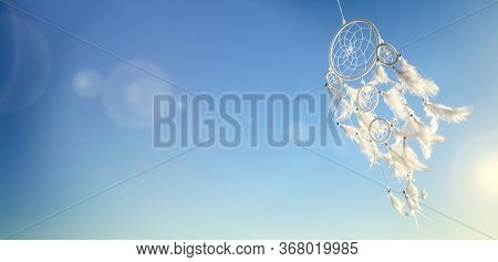 Dream catcher on blue sky sunset background with copy space