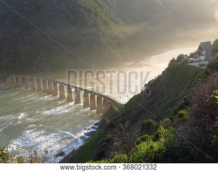 Old, Disused Railway Bridge Over The Kommetjie River And Surf Near George On The Western Cape Coast.