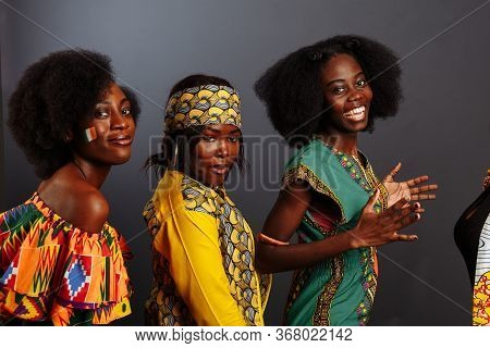 Three Young Beautiful African Fashion Models Have Fun And Laughing In Traditional Dress. Women From