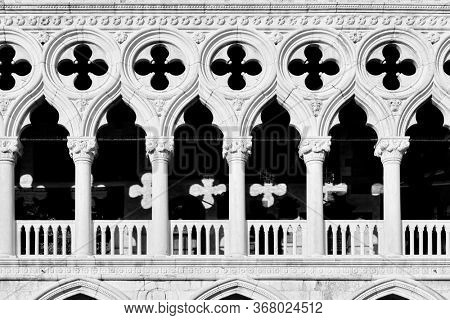 Gallery of Palazzo Ducale (Doges Palace) in Venice closeup, Italy. Black and white photography