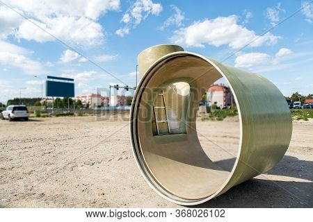 Pipes Of Large Diameter. Stacked Pipes In Construction Site ,transition Of A Pipe, Dismantling