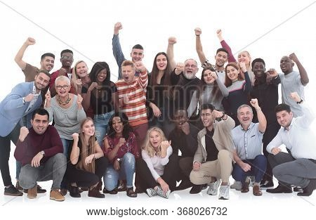Cheerful diversity group of people with hands raised