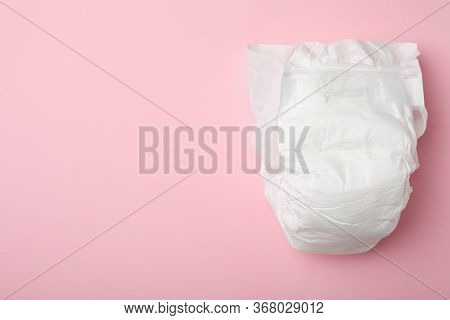 Baby Diaper On Pink Background, Top View. Space For Text