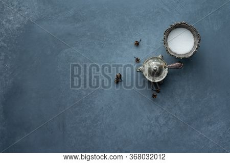 Salt And Sugar In Old Silver Bowls With Patina And Small Spoon On Grey Background. Top View.