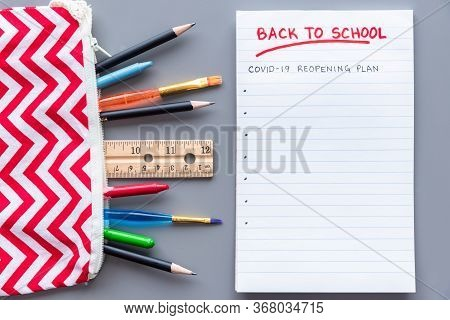 Back To School Covid-19 School Reopening Plan Concept Shot. Flay Lay Arrangement With School Supplie