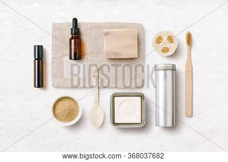 zero waste / zero plastic bathroom or spa: conceptual flatlay with natural and hand made beauty and skincare products made of natural materials and ingredients e.g. bamboo, loofah and essential oils