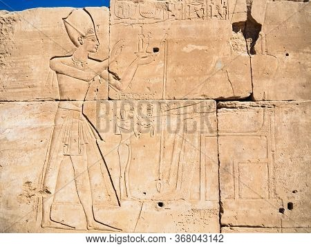 Egyptian Legends On Ruined Wall, Close Up View. Ancient Ruined Wall In Karnak Temple. Photographed I