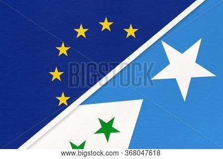 European Union Or Eu And Galmudug National Flag From Textile. Symbol Of The Council Of Europe Associ