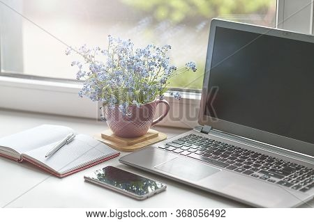 Workplace Near The Window With Computer. Copy Space. Modern Laptop On Desk Near Window At Home. Morn