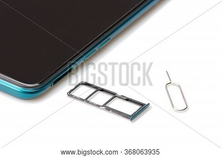 Sim Card Tools, Small Nano Sim Card, And Micro Sd Card Tray With Smartphones Isolated On White Backg