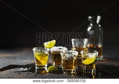 After Party Concept: Dirty Shots With Tequila, Lime And Salt On The Bar Table, Selective Focus