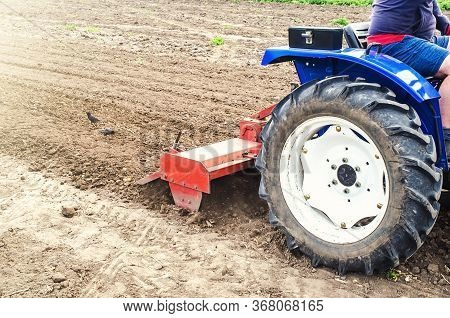 Tractor With Milling Machine Loosens, Grinds And Mixes Soil. Cultivation Technology Equipment. Loose
