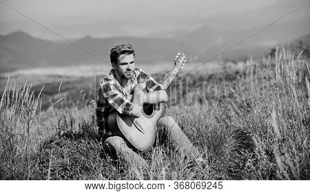 Wanderlust Concept. Inspiring Nature. Summer Vacation Highlands Nature. Musician Looking For Inspira