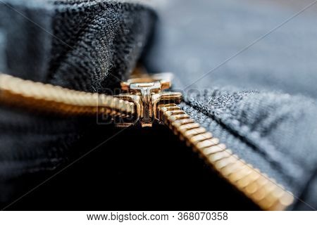 Close Up Image Of A Black Denim Jeans With Its Metal Zipper Or Fly Open And Zipper Tape Metallic Pul