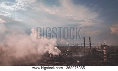 Smoke From The Chimney. View Point Of Smoking Chimney With Orange White Colors