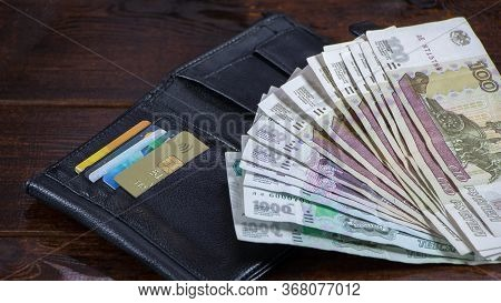 Lot With Russian Rubles Is On The Wallet With Credit Cards.paper Banknotes Russian Rubles.rubles Is
