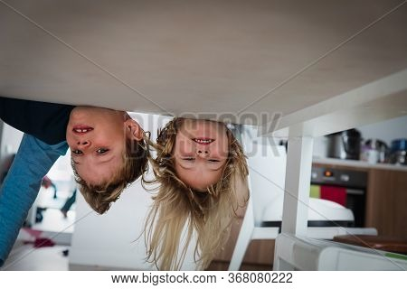 Kids Staying Home, Boy And Girl Play Hide And Seek Indoors