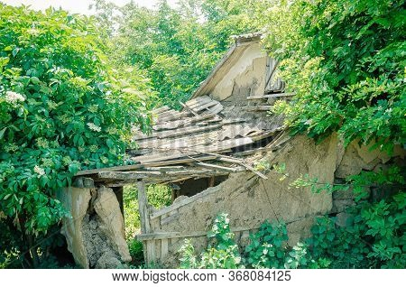 Old Collapsed House In The Village. Abandoned Place.