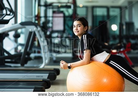 Photo Of Beautiful Young Sporty Woman. Girl Working Out With Fitness Ball