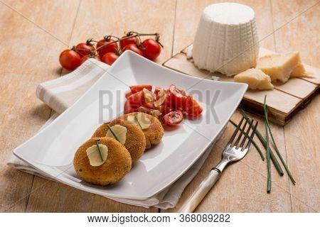 vegetarian ricotta cheese hamburger with tomatoes salad
