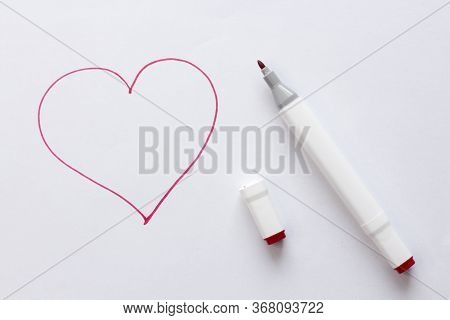 Drawn By A Bright Red Felt-tip Pen Or Marker A Red Heart On White Paper And A White Background. Love