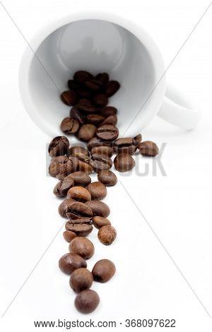 Coffe Beans On White Mug Isolated On White.