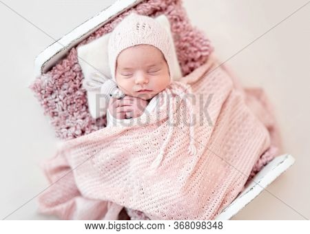 Top view of cute sleeping newborn with toy