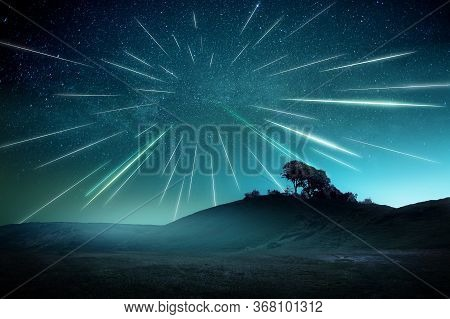 A Large Meteor Shower On A Misty Evening With Streaks Across The Sky. Shooting Stars Landscape Astro