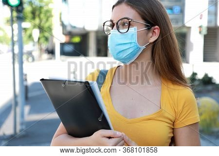 Covid-19 Beautiful University Student Female With Surgical Mask Walking In City Street. College Girl