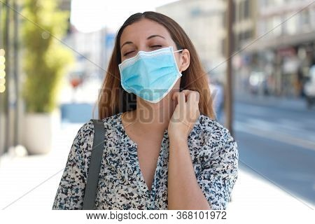 Young Woman With Surgical Mask Itching Allergy Symptoms Scratching Neck In City Street