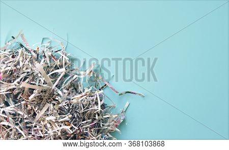 Shredded Paper On Light Blue Background. Selective Focus Image.