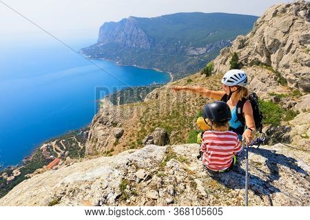 Child, Young Mother Sit On Mount Top. Look At Amazing Sea Landscape. Family Travel Adventure, Hiking