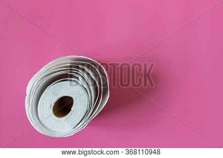 One Toilet Paper Roll Isolated On Pink Background Top View. Roll Out Toilet Paper Imitated Flower Bl